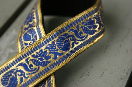 Image of camera strap - peacock on gold