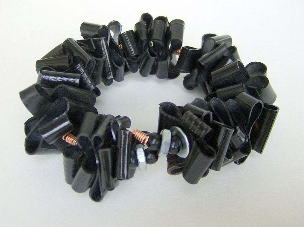 Bracelet made from recycled bicycle tires.