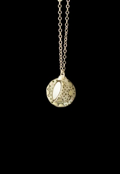 Image of silver spotty cup and saucer necklace