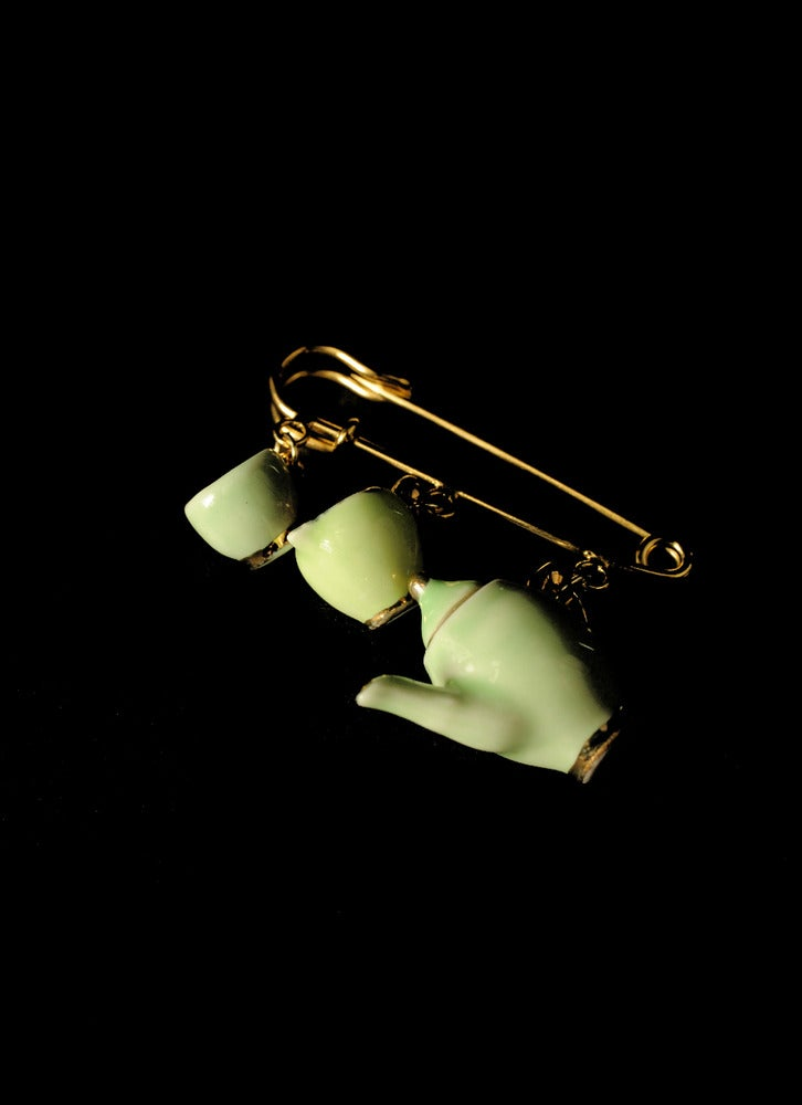 Image of green and gold kilt pin