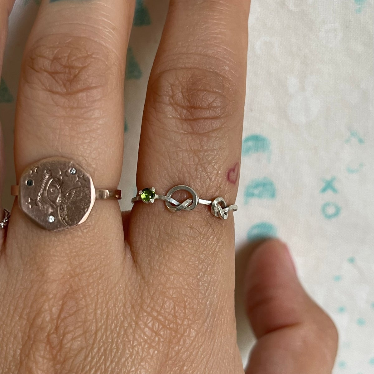 Image of two knot and stone ring