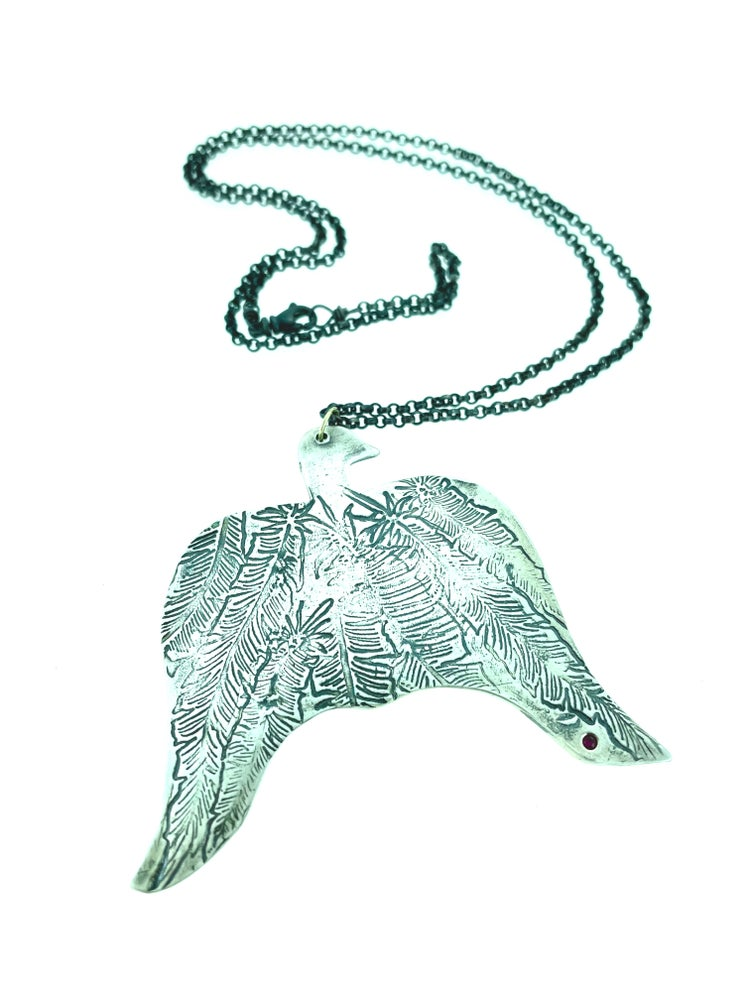 Image of thunderbird statment necklace with Rumi quote