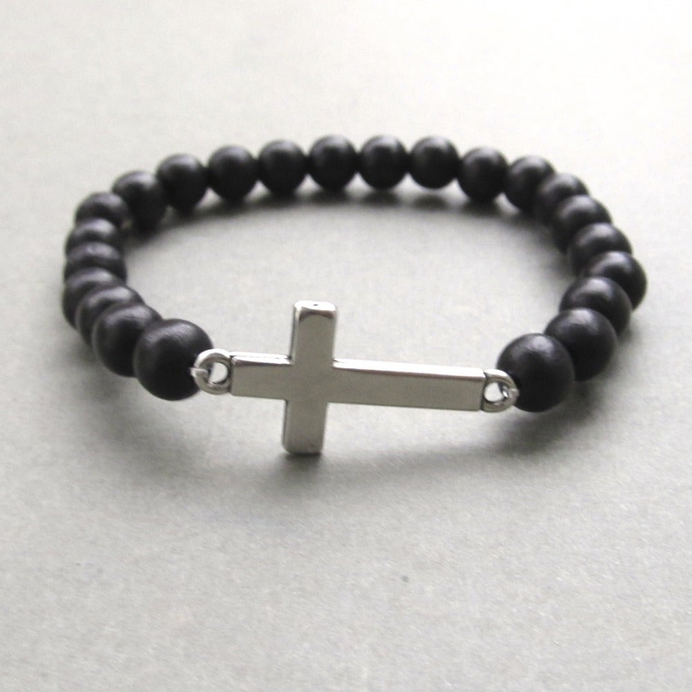Image of Black beaded stretch bracelet with sideways cross