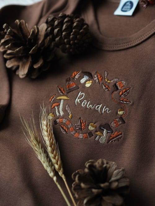 Image of A Rustling Stroll - Cinnamon sleepsuit