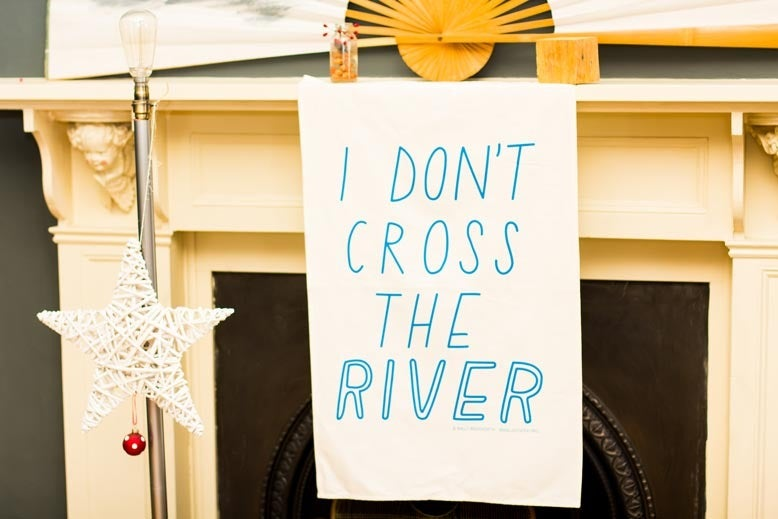 Image of I don't cross the river Tea Towel