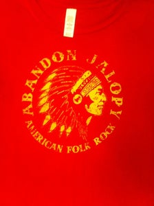 "Image of Red AJ T-shirt with machine sewn ""Ltd"" badge"