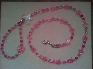 Image of Transparent and pink crystal beaded dog lead.