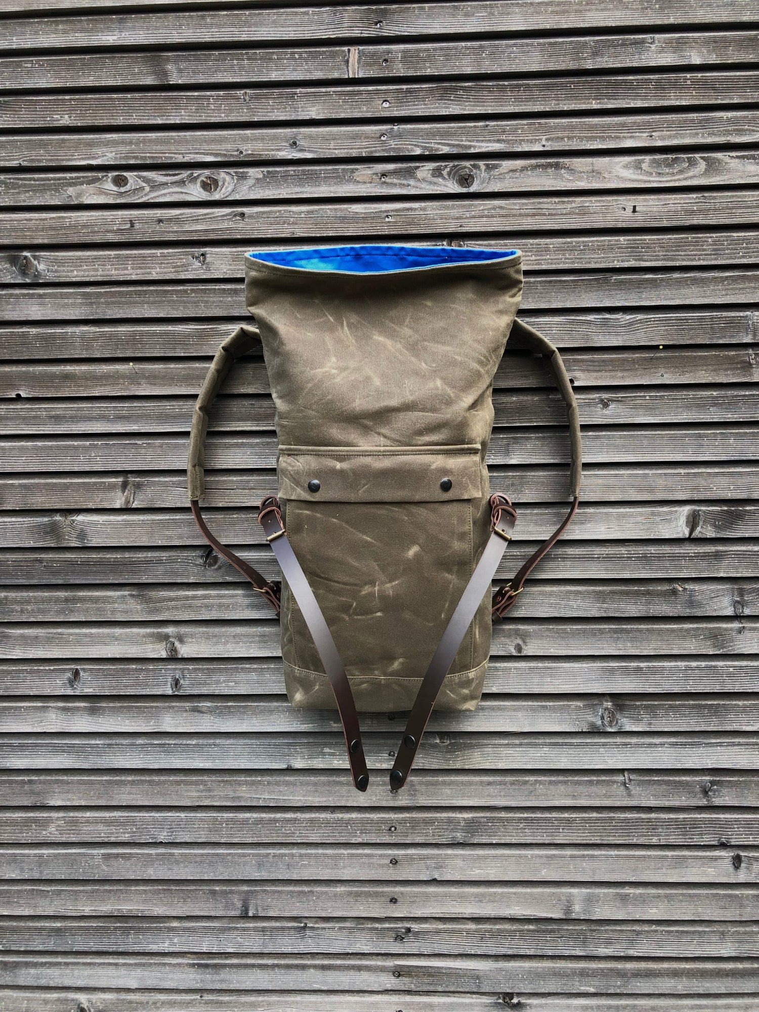 Image of Field tan backpack medium size rucksack in waxed canvas, with volume front pocket and double layered