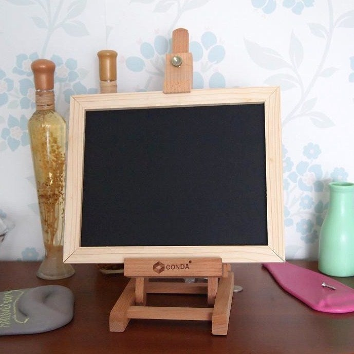 Image of rectangular wooden chalkboard with brown border and stand