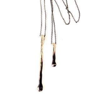 Image of two drip lariat