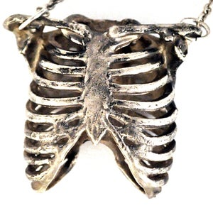 Image of Ribcage antique white brass