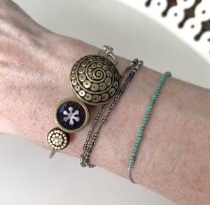 "Image of ""The Artist"" Vintage Button Bracelet"