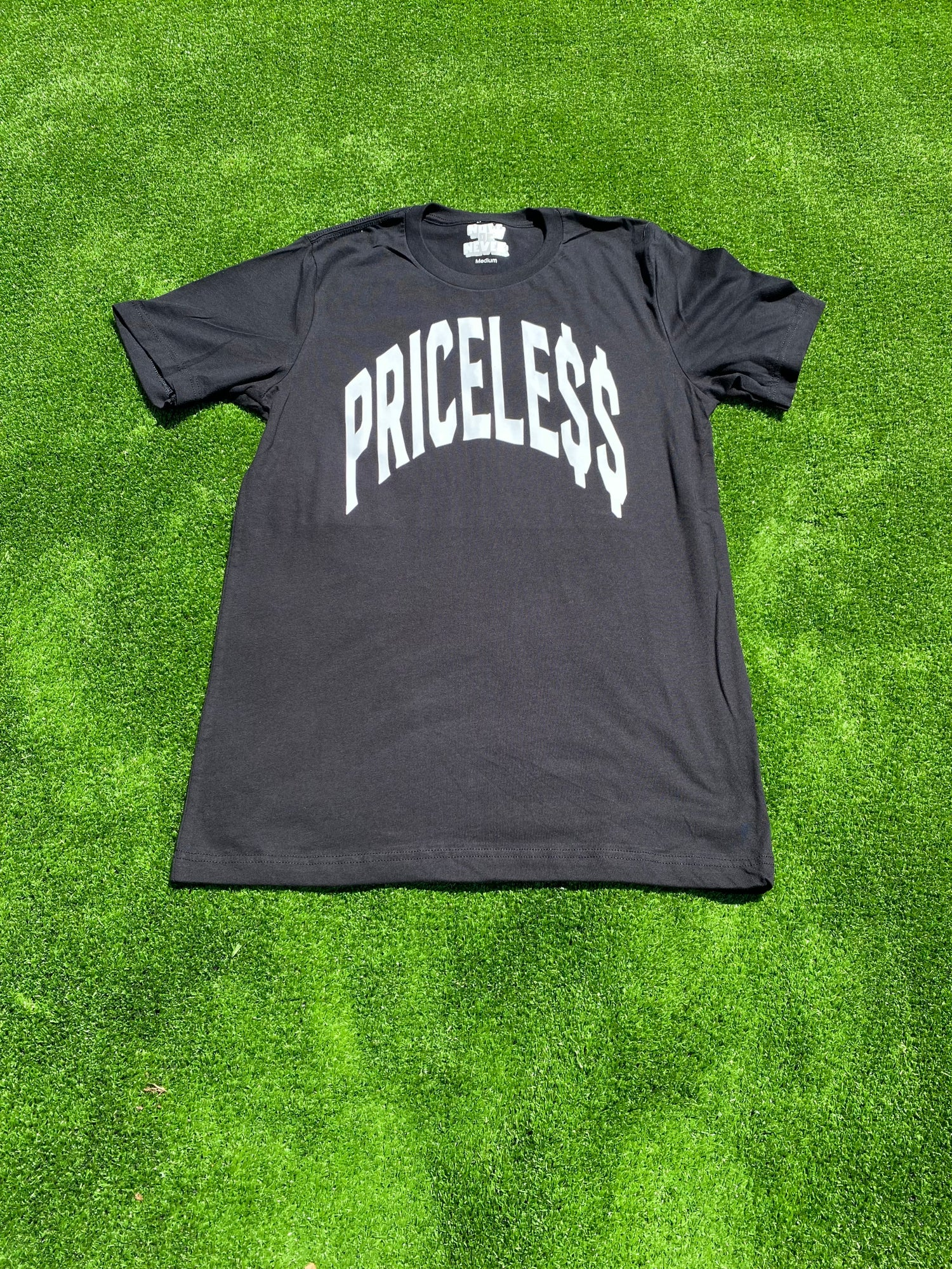 Your life is pricele$$ bold print T-shirt black with white print