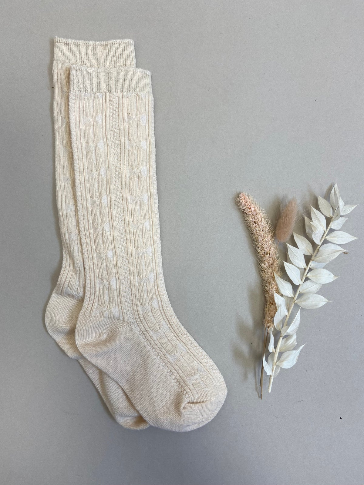 Cream cable knit knee high socks